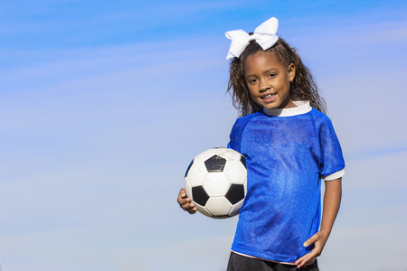 simple girl: Smiling young african american soccer player portrait with lots of copy space