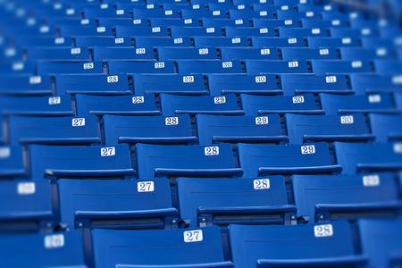 sports venue: Blue stadium seats selective focus Stock Photo