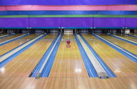 bowling pin: Generic Bowling Alley lanes with bowling ball going towards the pins
