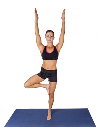 yoga mat: Fitness woman doing yoga on a yoga mat. Isolated on a white background