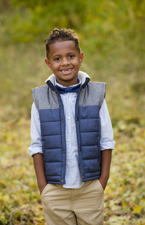 racially diverse: Cute outdoor portrait of a smiling African American young boy