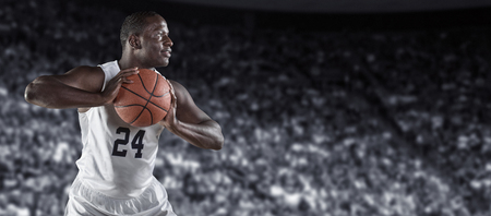 African American Basketball Player in a large basketball arena Stock Photo