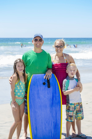 simple girl: Portrait of a beautiful young Family at the beach Stock Photo