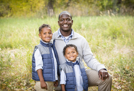 Outdoor Portrait of a Racially Diverse Father with his two sons 写真素材