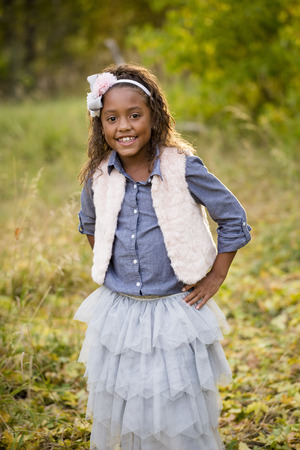 racially diverse: Cute outdoor portrait of a smiling African American little girl