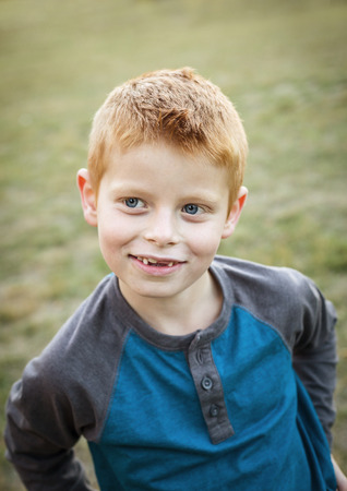 haired: Cute and Silly Little red haired boy portrait outdoors