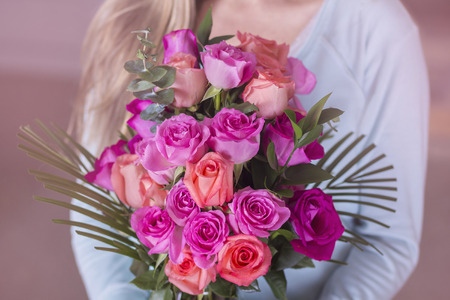 the admirer: Woman holding a bouquet of beautiful pink roses
