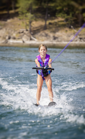 water skier: Young girl Water skier on a beautiful scenic lake