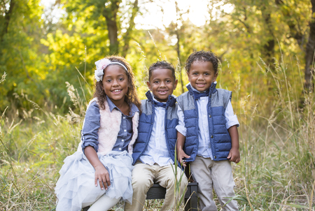 racially diverse: Cute outdoor portrait of three racially diverse children