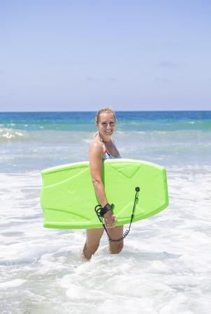 boogie: Attractive woman boogie boarding in the ocean waves