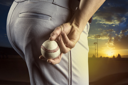 baseball pitcher: Baseball pitcher ready to pitch in an evening baseball game