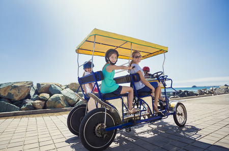 tandem bicycle: Family on a surrey bike ride along the coast of California Stock Photo