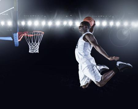 Basketball Player scoring a slam dunk basket