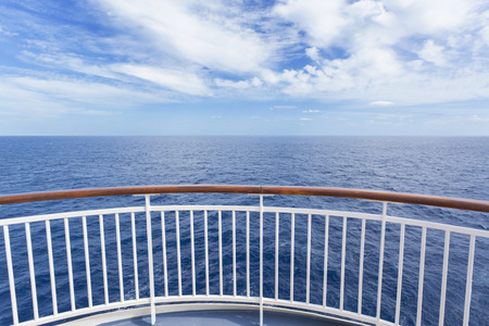 caribbean cruise: Beautiful and scenic view from a cruise ship deck of the gorgeous deep blue ocean and blue sky