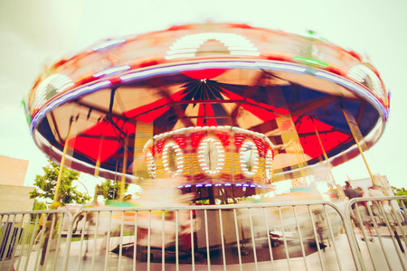 intentional: Merry-Go_Round Spinning at amusement park Stock Photo