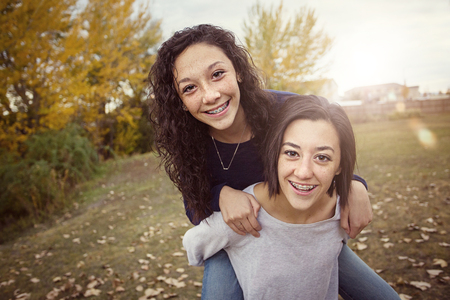 Hispanic Teenage girls having fun together outdoors