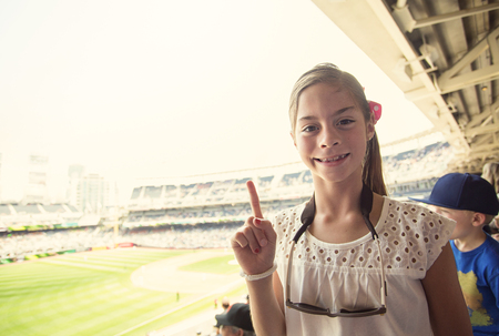 Happy Child enjoying a day at a baseball game photo