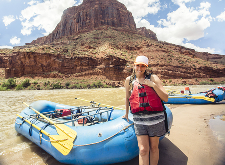Woman on a rafting trip down the Colorado River Standard-Bild