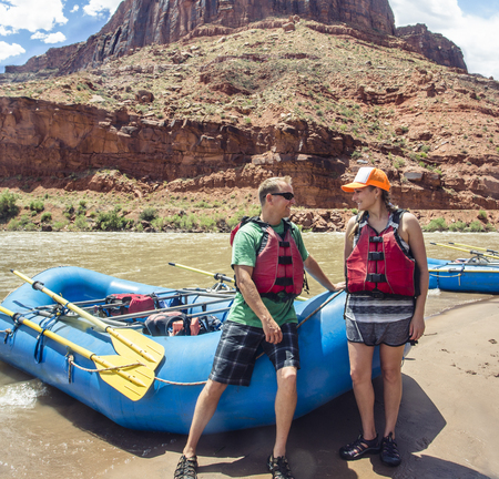 Couple on a rafting trip together down the scenic Colorado River near Moab, Utah Banco de Imagens