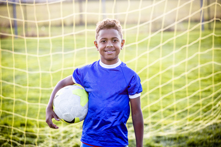 Diverse young boy on a youth soccer team Stock Photo