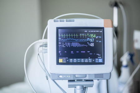 Medical vital signs monitor instrument in a hospital. This health care device displays and monitors heart rate and oxygen levels in hospital patients