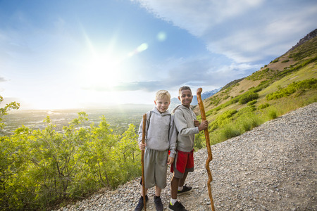 Boys Hiking up a beautiful mountain trail in the summer
