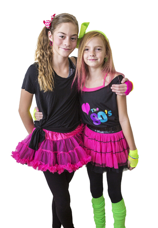 Cute girls dressed in retro 80s decade costumes. Smiling happy girls isolated on a white background Banque d'images