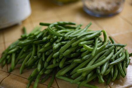 Delicious pile of fresh organic green beans ready to be cooked