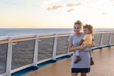 A mother and her son enjoying a Caribbean Cruise vacation together. Candid photo of a family enjoying their time on board a cruise ship together.