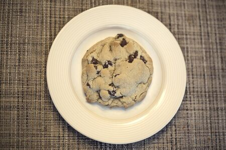 Above view of a Delicious Chocolate Chip cookie on a plate
