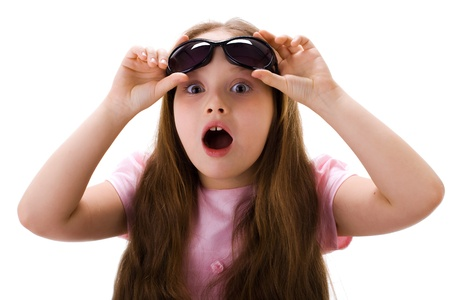 little girl surprised: Cute little girl surprised with something Stock Photo