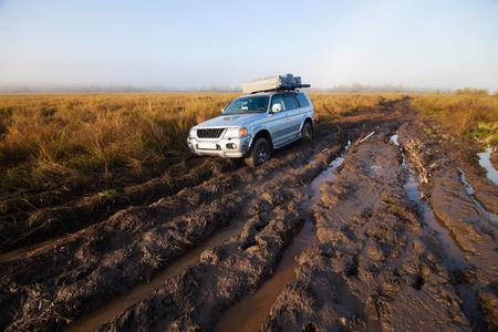 stuck: 4x4 car stuck in mud Stock Photo