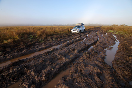 4x4 car stuck in mud Stock Photo