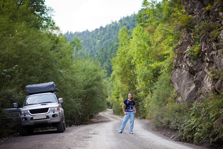 the far east: Woman and SUV on the forest roan in the Far East of Russia