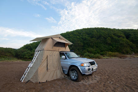 Car with roof tent at the sea shore