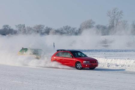 drifting ice: Red car moving on snow with blurred background