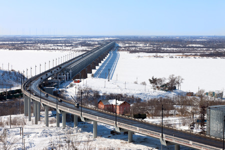 frozen river: Bridge over the frozen river in winter Stock Photo