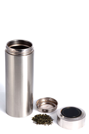stainles steel: Chinese personal thermal bottle with green tea leafs for traditional chinese drink isolated on white Stock Photo
