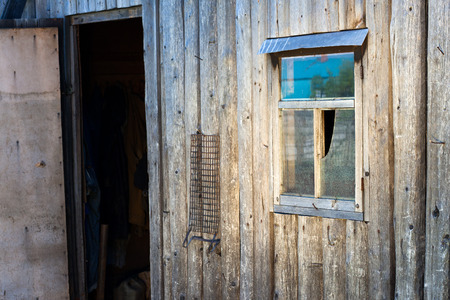 hobnail: Opened door of a wooden barn. Country background