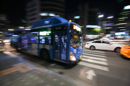 City bus motion blurred in the night in Seoul Фото со стока