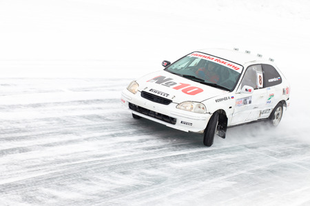 civic: KHABAROVSK, RUSSIA - March 7, 2015: Honda civic at winter ice track race on frozen lake