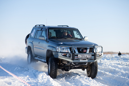 nissan: KHABAROVSK, RUSSIA - JANUARY 31, 2015: Nissan Patrol during off road winter sprint race Editorial