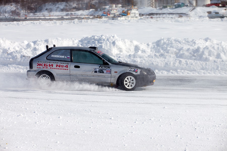 frozen winter: KHABAROVSK, RUSSIA - March 7, 2015: Honda civic at winter ice track race on frozen river Editorial