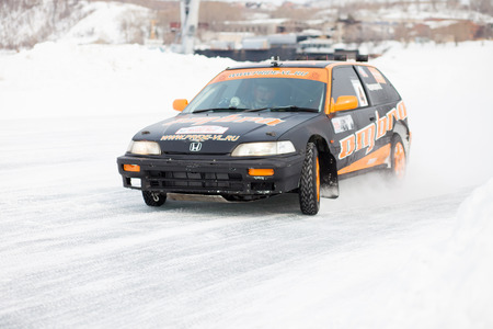 civic: KHABAROVSK, RUSSIA - March 7, 2015: Honda civic at winter ice track race on frozen river Editorial