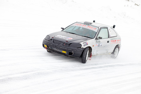 honda: KHABAROVSK, RUSSIA - March 7, 2015: Honda civic at winter ice track race on frozen river Editorial