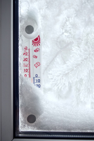 sub: Outer thermometer on a frozen window showing sub zero temperature