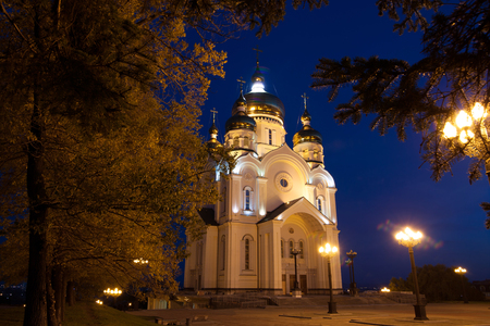 ortodox: Ortodox cathedral in Khabarovsk, Russia in the night. And autumn trees around it. Stock Photo