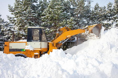 wheel loader: Wheel loader is cleaning a road from snow