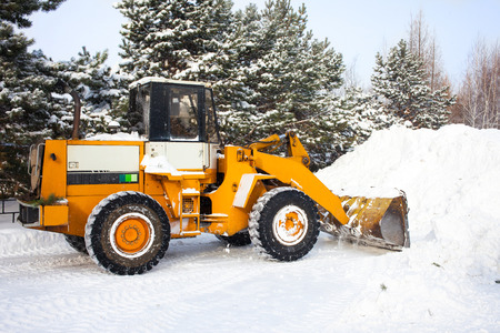 ice storm: Wheel loader is cleaning a road from snow in Khabarovsk, Russia