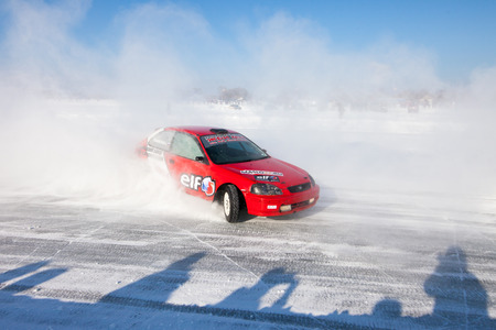 cornering: Khabarovsk, Russia -  January 17, 2016: Honda civic at winter ice track race on frozen river.The race is held on ice of Amur river in Khabarovsk. The picture was taken during cornering. Studded tyres are used for this race. Maximum speed on the track is o